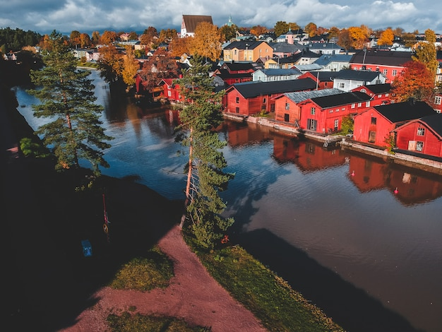 Aerial view of the old red house and barns by the river Premium Photo