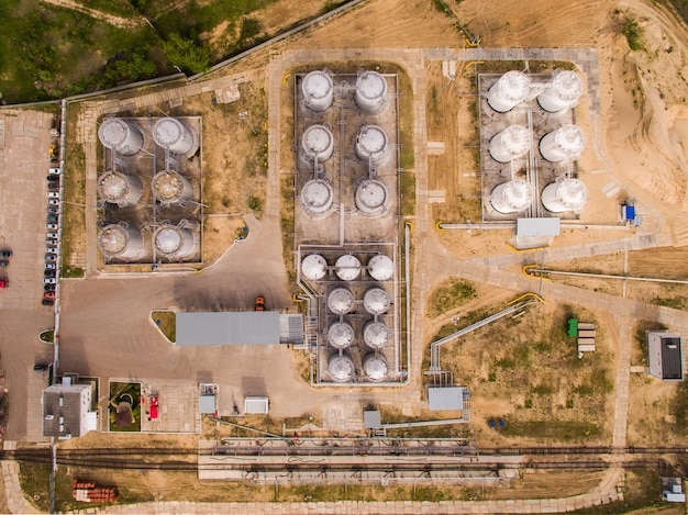 Aerial view of petrol industrial zone on sand. top view Premium Photo
