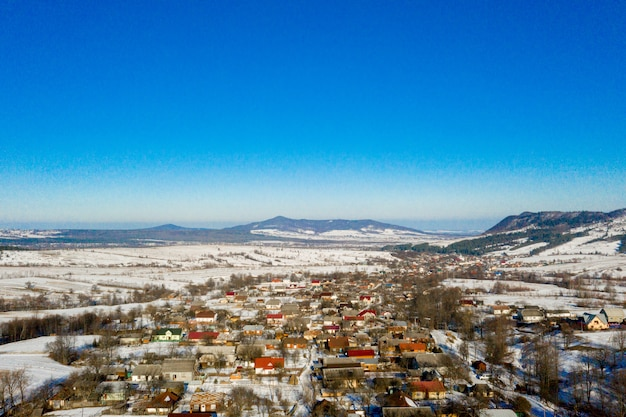 Aerial view over private houses in wintertime Premium Photo
