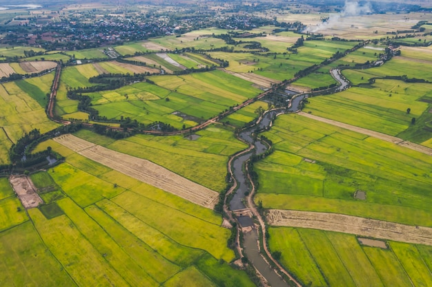 Aerial view of road and devious river in a fields Premium Photo