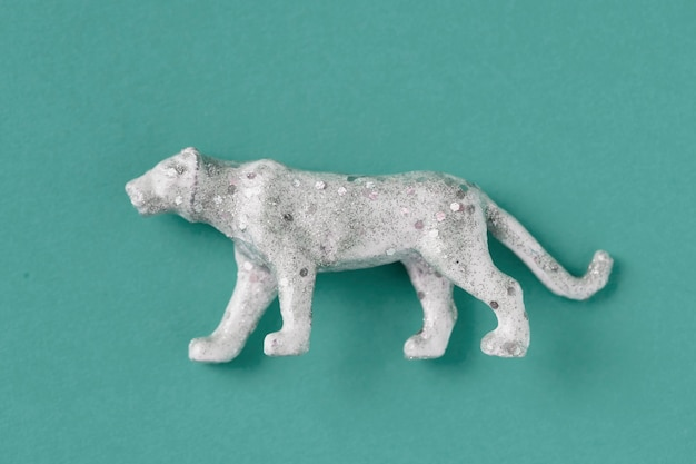 Aerial view of shiny animal figurine tiger with effects Free Photo