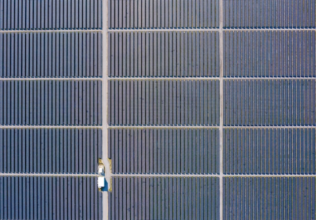 Aerial over view solar cells area factory farm in thailand Premium Photo