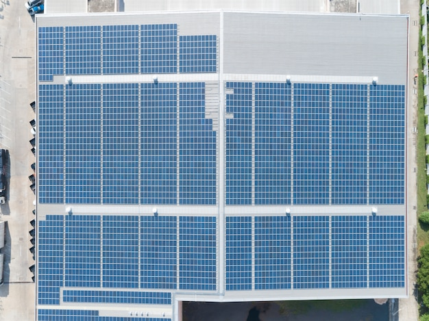 Aerial view of solar panel on factory rooftop Premium Photo