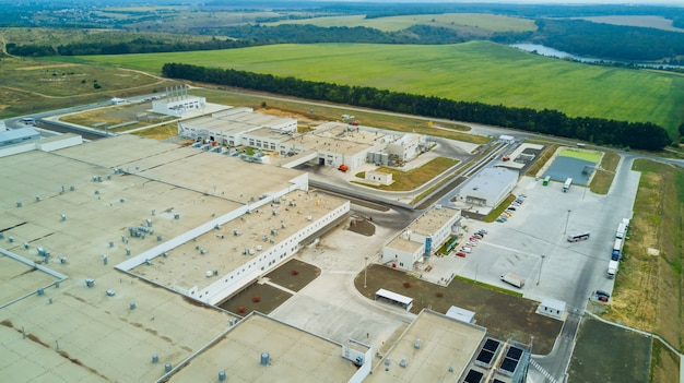 Aerial view of stylized altered generic modern industrial building. Premium Photo