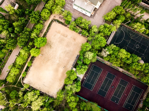 Aerial view of summer sport camp courts and building in the forest Premium Photo
