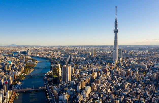Вид с воздуха восход токио сити горизонт, япония. Premium Фотографии