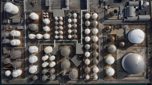 Aerial view of tank terminal with lots of oil storage tank and petrochemical storage tank in the harbour, industrial tank storage aerial view. Premium Photo