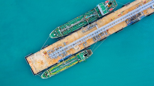 Aerial view tanker ship unloading at port, business import export oil with tanker ship. Premium Photo