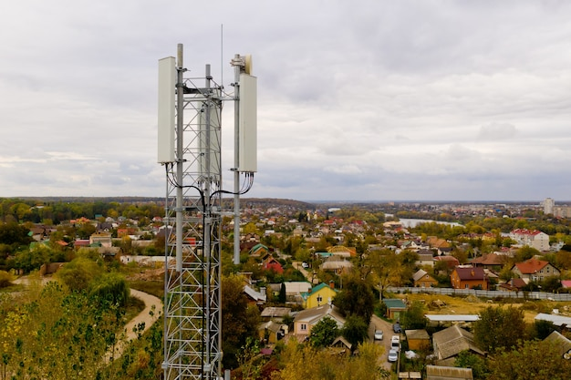 Aerial view of tower with 5g and 4g cellular network antenna. Premium Photo