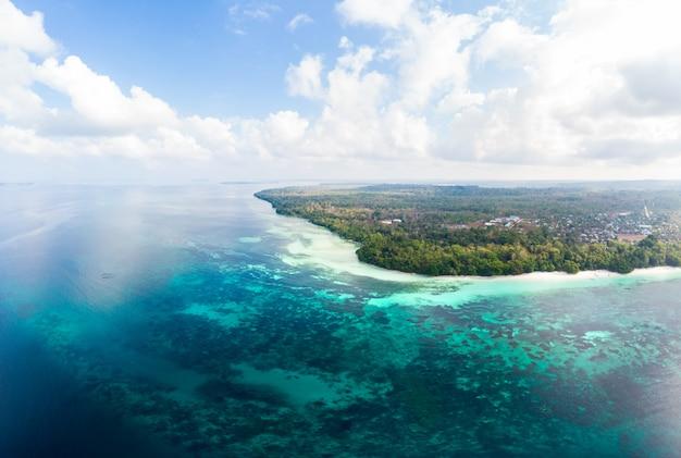 Aerial view tropical beach island reef caribbean sea at kei island, indonesia moluccas archipelago. Premium Photo