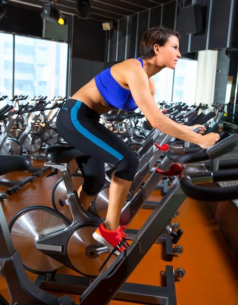 Aerobics spinning woman exercise workout at gym Premium Photo
