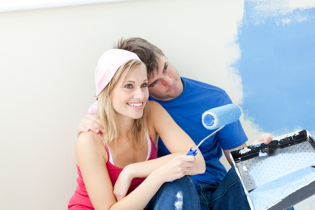 Affectionate couple painting a room Premium Photo