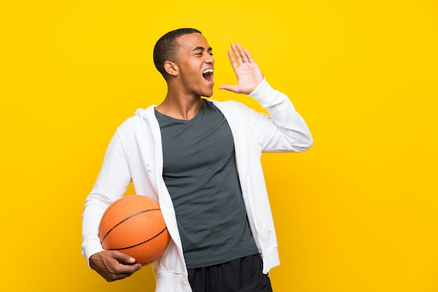African american basketball player man shouting with mouth wide open Premium Photo
