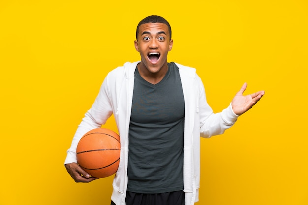 African american basketball player man with shocked facial expression Premium Photo