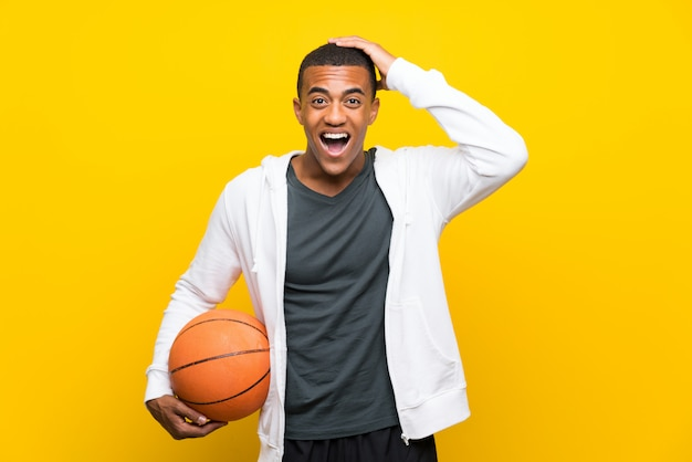 African american basketball player man with surprise and shocked facial expression Premium Photo