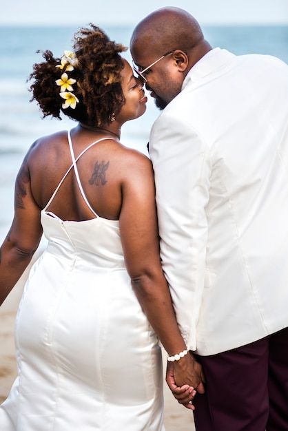 African american couple getting married at the beach Free Photo