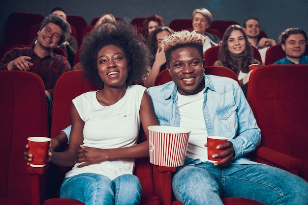 African american couple watches comedy in movie theater. Premium Photo