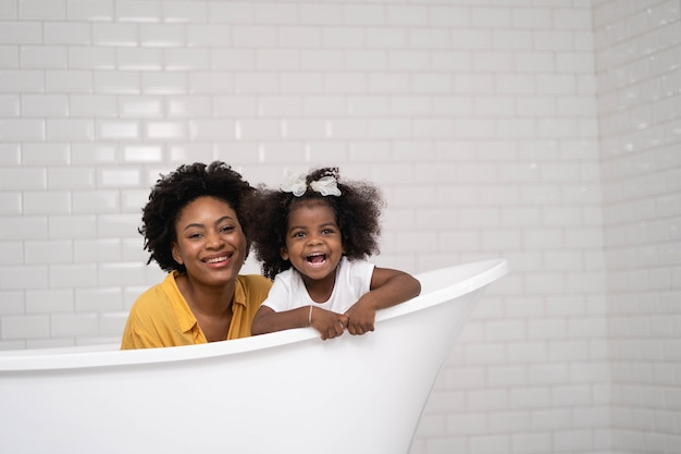 African american family, happy mother and baby daughter having fun Premium Photo