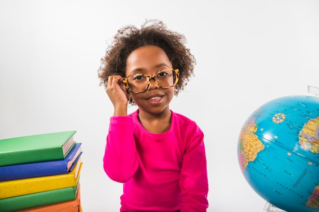 African-american kid in glasses in studio Free Photo