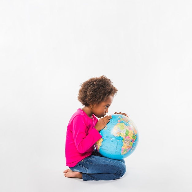 African-american kid with globe in studio Free Photo