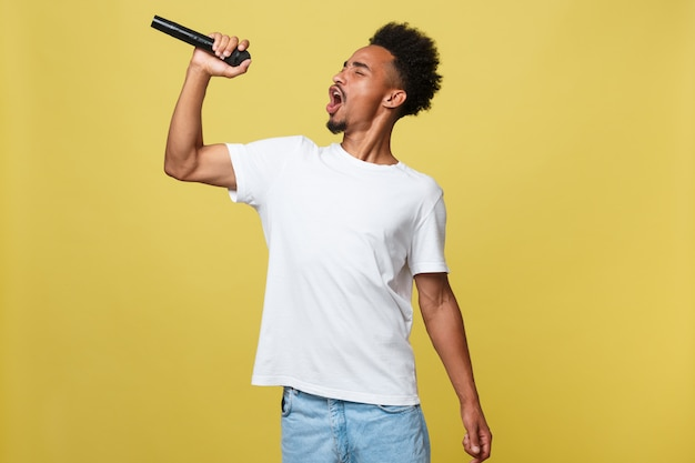African american male singer performing with microphone. Premium Photo