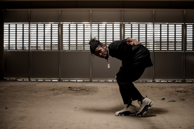 African american man in black clothes in dance Premium Photo