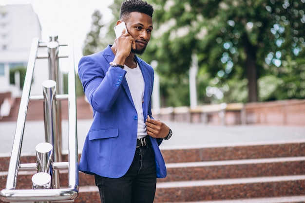 African american man in blue jacket using phone Free Photo
