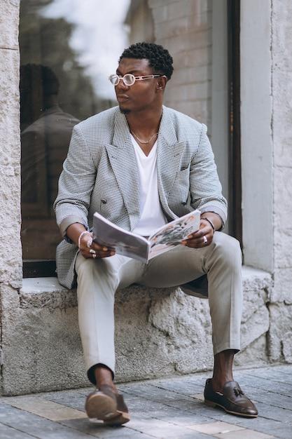 African american man reading magazine Free Photo