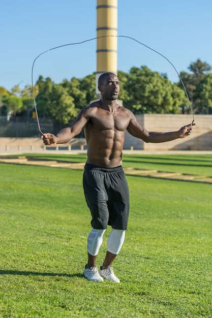 African american man training  jumping rope Premium Photo