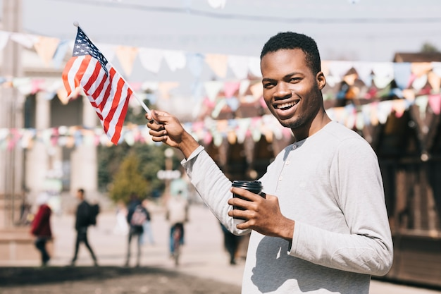 African american man with usa flag on festival Free Photo