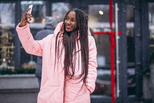 African american woman doing selfie on phone Free Photo