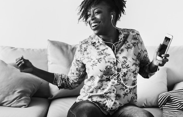 African american woman enjoying music at home leisure and music concept Free Photo
