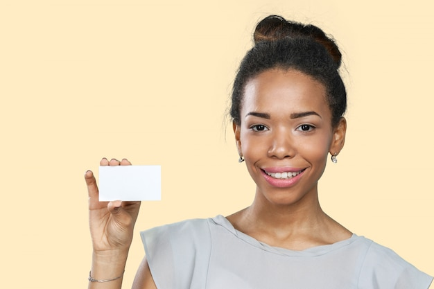 African american woman holding blank paper Premium Photo