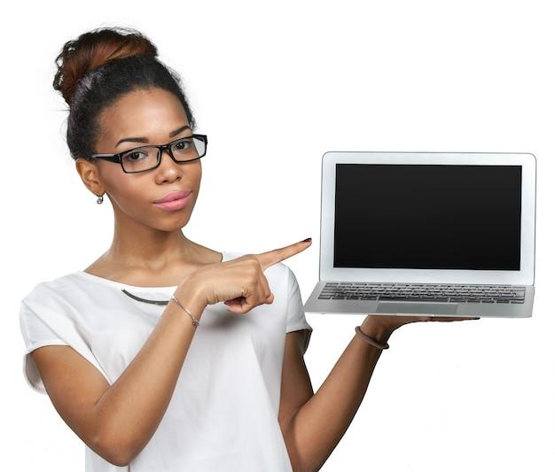 African american woman holding laptop Premium Photo