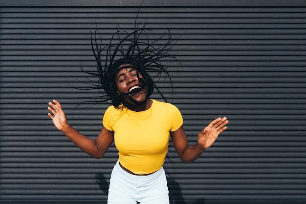 African american woman waving her dreadlocks Premium Photo