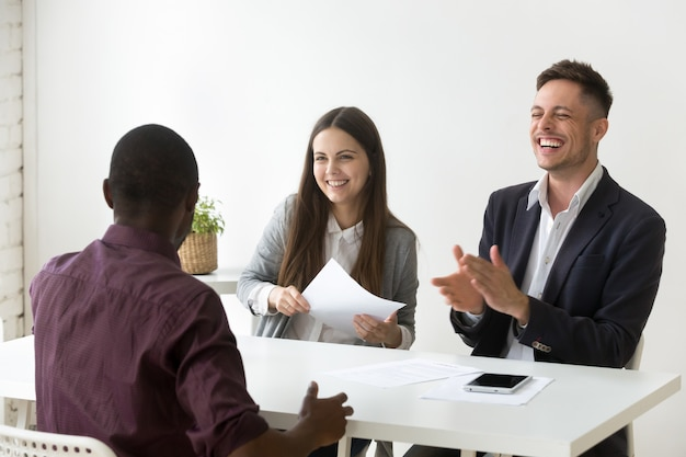 African applicant make hr laugh at job interview, good impression Free Photo