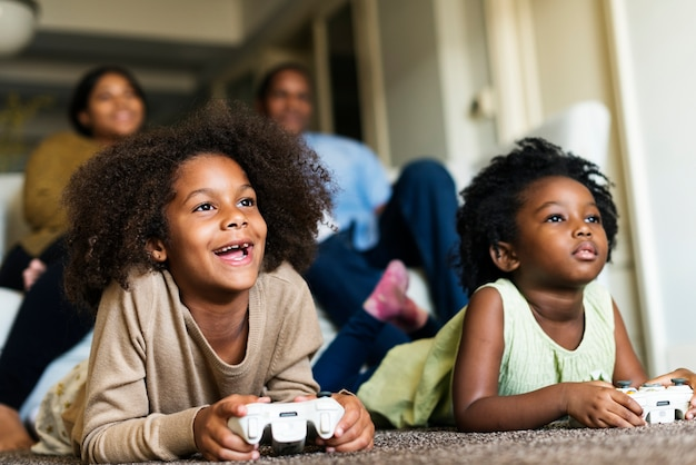 African children playing video games | Premium Photo