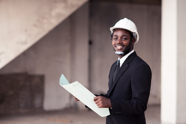 African engineer man stand up and smilling Premium Photo
