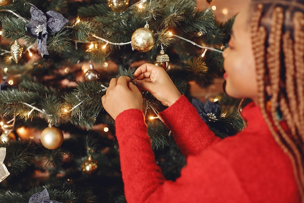 Free Photo African Girl In A Christmas Decorations Woman In A Red Sweater New Year Concept