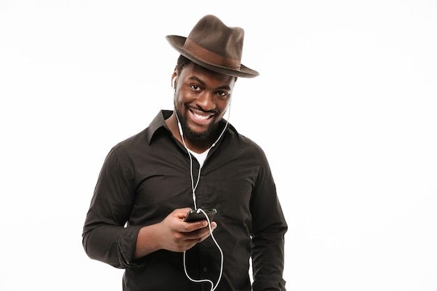 African man chatting by phone and listening music Free Photo