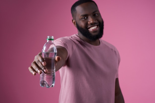 Premium Photo | African man drinking water