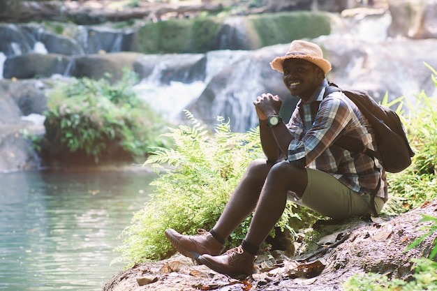 African man traveler with backpack smiling and relaxing Premium Photo