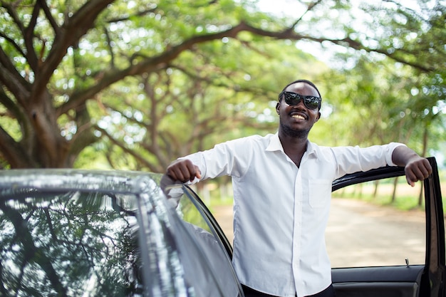 African man wearing a white shirt and sunglasses Premium Photo