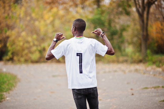 African man in white football sport t-shirt of ghana africa country with 7 number. Premium Photo