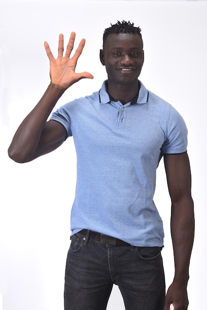 African man with finger in the shape of number five Premium Photo