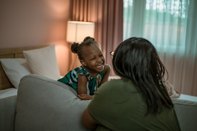 African mother and daughter playing together. Premium Photo
