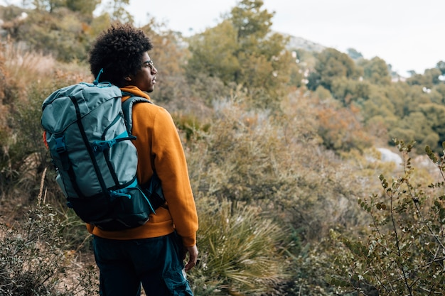An african young male hiker hiking with backpack Free Photo