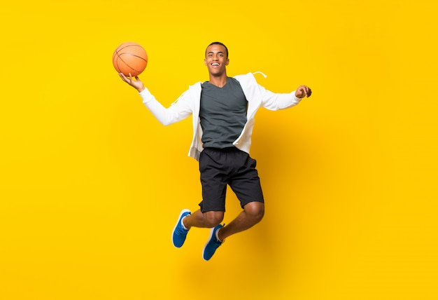 Afro american basketball player man  isolated on yellow Premium Photo