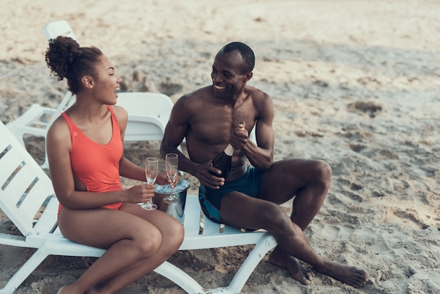 Afro-american couple is resting on river beach Premium Photo