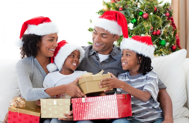 Afro-american family celebrating christmas at home Premium Photo